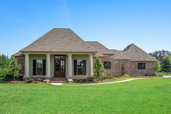 Polo Farms Exterior with brick and wood siding. Large entry doors with massive door light. Inviting front porch that looks out onto the massive yard. Private side entry garage.