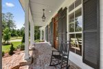 Shaded front porch that is a great place` to sit and enjoy the Louisiana weather.